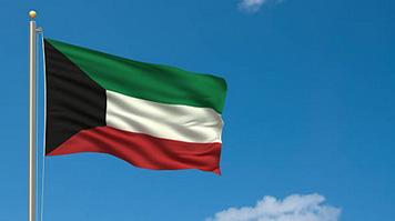The Kuwait flag against the sky