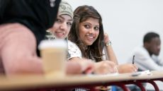 Girl smiling in a lecture