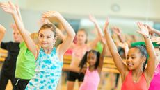 Kids waving their arms in a dance class