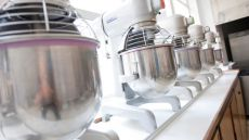 A row of industrial cake mixers
