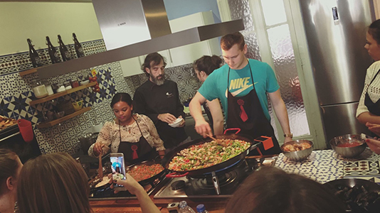 Tourism students preparing paella