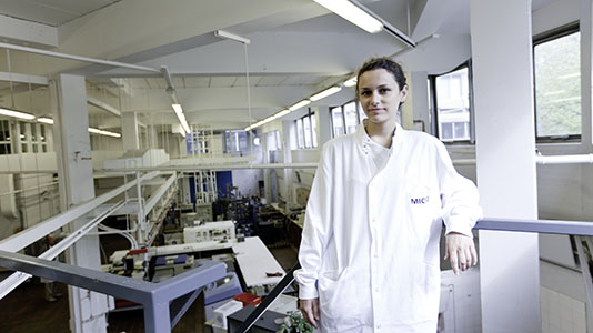A student in a food science lab, where biochemistry and human nutrition studies take place