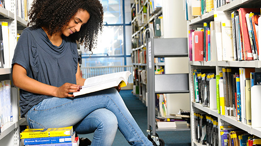A London South Bank University (LSBU) student in one of our libraries.