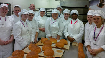 Bakery students with their loaves of bread
