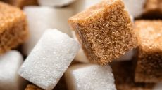 A close-up of brown and white sugar cubes
