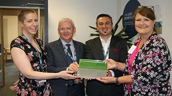 LSBU staff members receiving Institute of Customer Service ServiceMarks