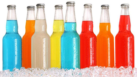 a line of bottles with a mix of coloured contents