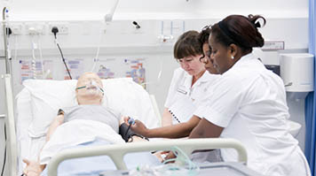 Student nurses tend to SimMan