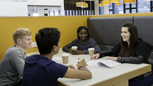 A group of student sitting in a café booth