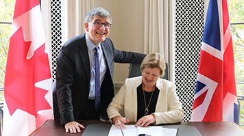 Charles Falzon and Janet Jones sign the Global Campus Network agreement