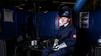 Female technician sitting down