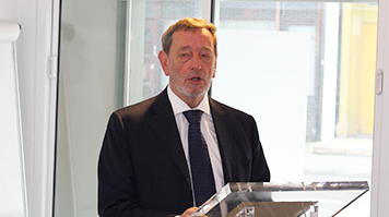 David Blunkett speaking at a podium