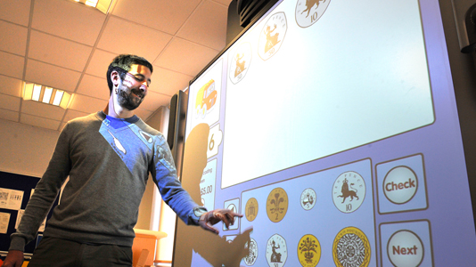 Teacher with interactive screen