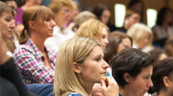 Delegates listening at a conference at LSBU