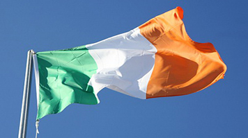 The flag of the Republic of Ireland against the sky