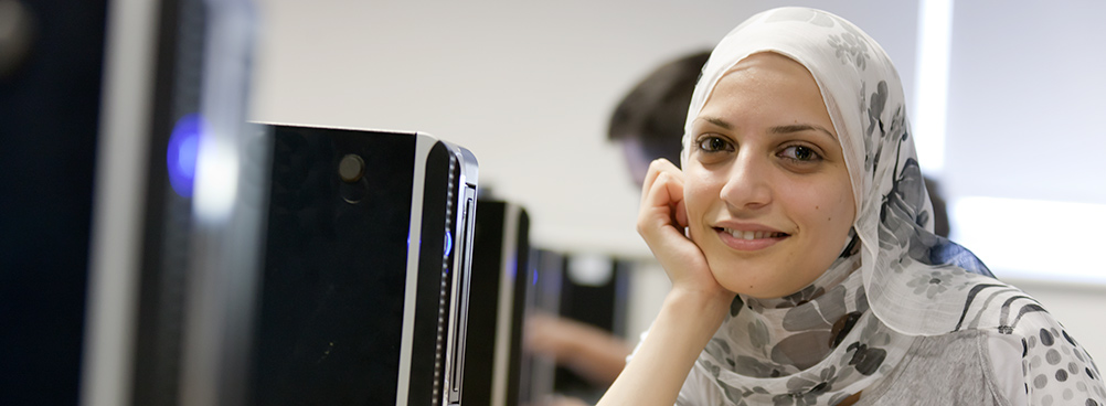 LSBU student by a computer