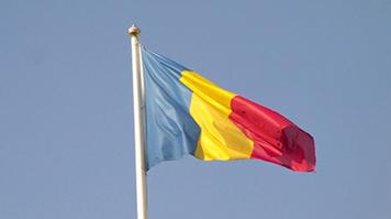 The flag of Romania against the sky