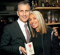 Tom Toumazis celebrating his MBE with wife Helen