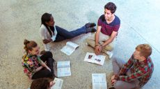 Students sitting on the floor