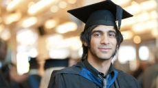Male graduate wearing a robe