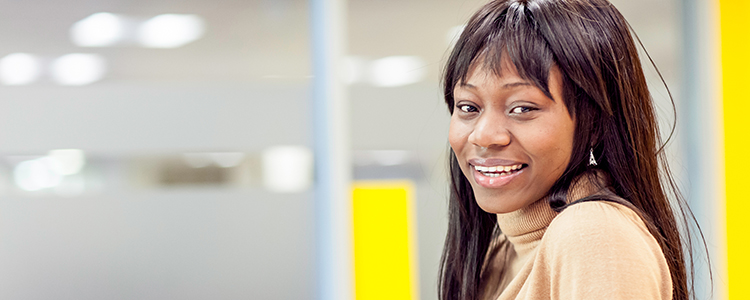 A smiling woman at LSBU