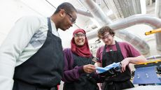LSBU Product Design students working in an engineering workshop.