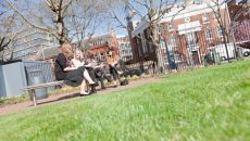 Students on a bench outside Southwark campus
