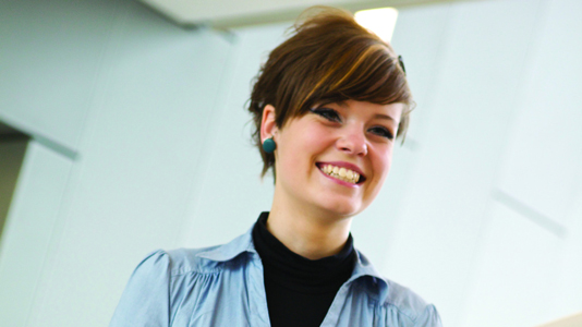 A nursing student smiling