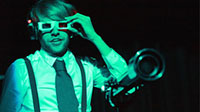 A man wearing 3D glasses during a drama performance