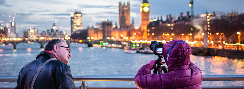 A person taking a photograph of the London skyline