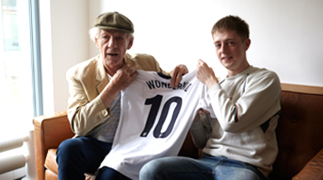 Sir Ian McKellan and Rhys Chapman show the Wonderkid football shirt