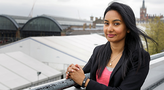 A woman on a bridge in London
