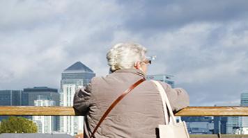 Old woman on a bridge