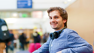 A smiling student with headphones
