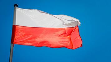 The Poland flag against the sky