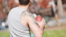 A student throwing an american football