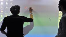 Teachers using an interactive whiteboard