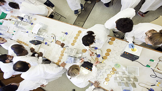 Students using equipment in the microbiology lab