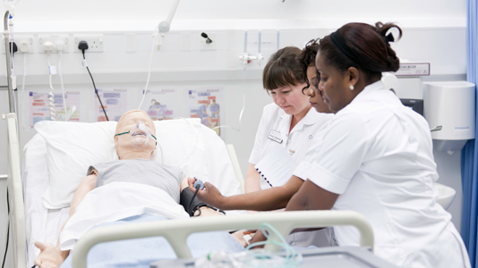 Student nurses tending Sim Man