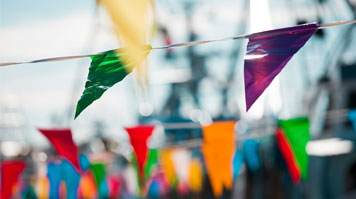 Coloured bunting against blue sky