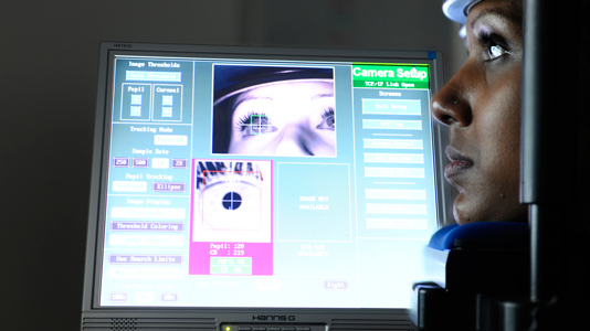 A student using the eye-tracking facility