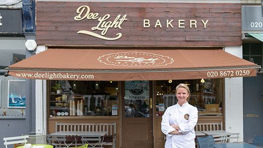 Dee outside her business, Dee Light Bakery