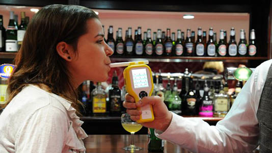 A student gets a breathalyser test at the Pub Lab
