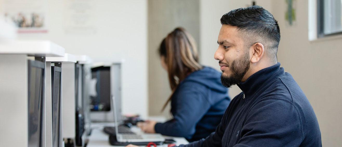 Man looks at computer