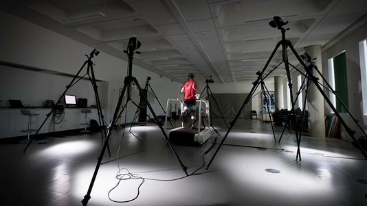 A man on a running machine undertaking Gait Analysis