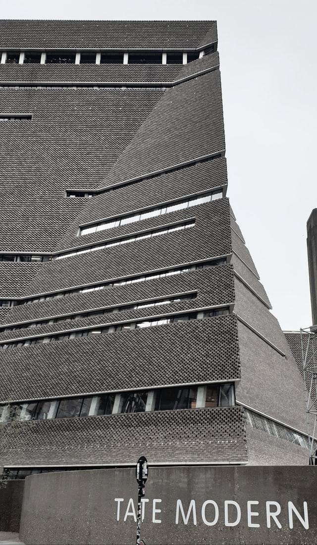 very modern stone building; arty