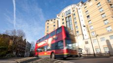 A bus passing Mclaren House student accommodation