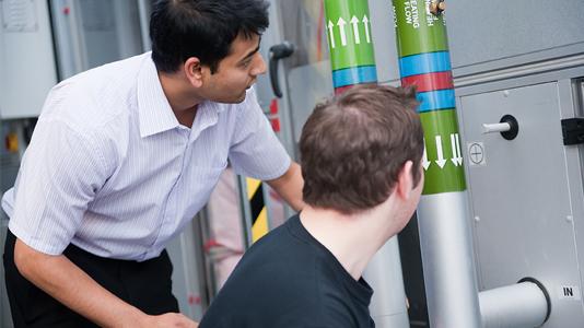 Students examine ventilation pipes