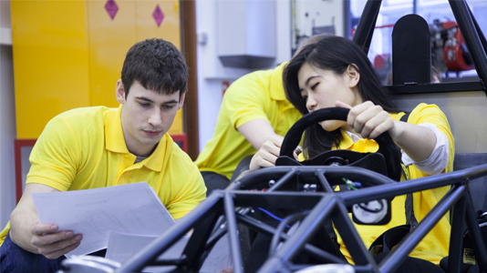 Students work as part of LSBU's IMechE Formula Student team