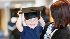 Young boy in a graduation hat